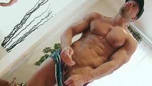 Muscular dude with awesome abs wanks off in front of a camera