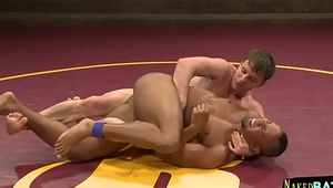 Ebony muscle stud wrestles on the floor