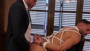 Dominant hunk wears suit and tie while slamming his sub