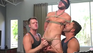 Blindfolded submissive stud getting tugged