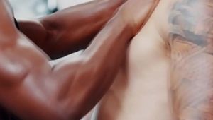 Interracial gay sex in the gym