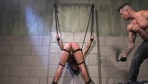 Stud getting flogged during kinky bondage