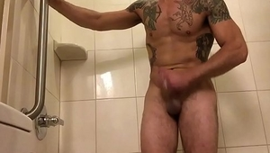 Solohaze loses dare and has to jerk off in the shower for his hotel stranger friend.  This is my first experience with a guy and its on film!