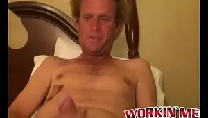 Mature dude strokes his massive cock while smoking a cigar